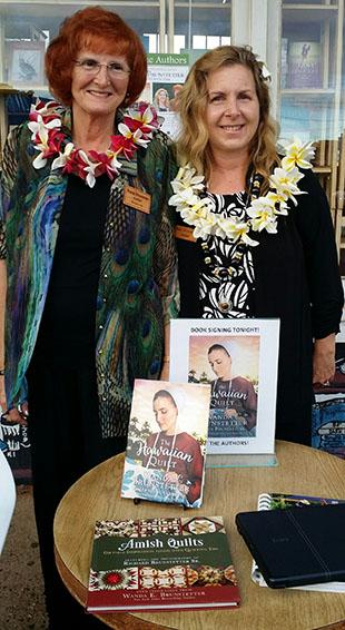 Wanda signing books in Kauai, Hawaii with co-author, Jean.